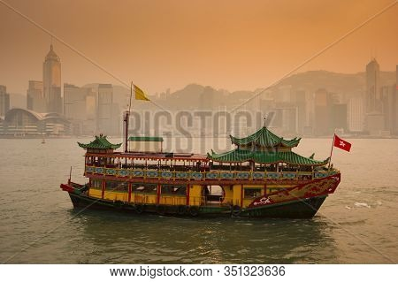 Chinese Traditional Ferry Is Running At Victoria Harbor In Hong Kong, China.