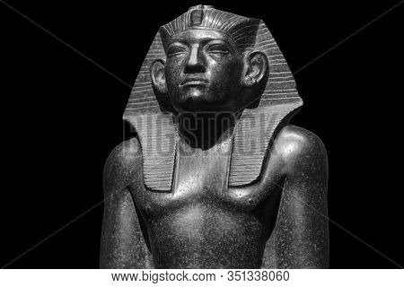Pharaoh Egyptian gods dead religion symbol stone statue isolated on black. Stone pharaoh tutankhamen mask on black background