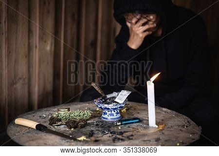 Women Who Show Stress And Loneliness, Homeless Man Drug  Addict Sitting Alone And Depressed  At An A