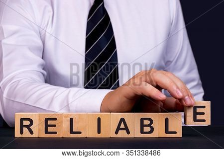 Man Made Word Reliable With Wood Blocks