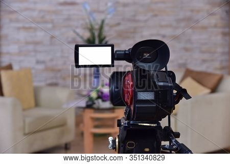 Camcorders Video Tape Interviews Television Programs  In Small Room