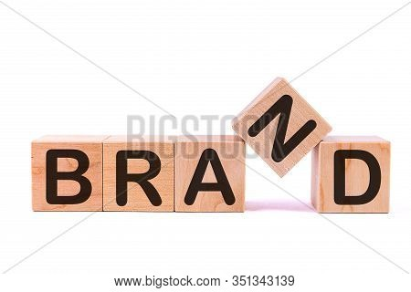 Wooden Cubes With The Word Brand. Corporate Identity, Marketing, Business.