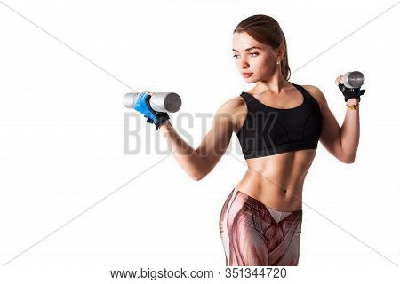 Pretty Young Muscular Woman Fitness Instructor In Sportswear Holding Iron Dumbbells In Her Hands On