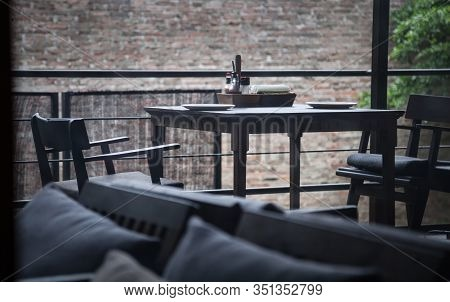 Rustic Indoor Wooden Dining Table, Crockery, Cutlery And Napkin Setting. Hotel Dining Venue, Food Ca