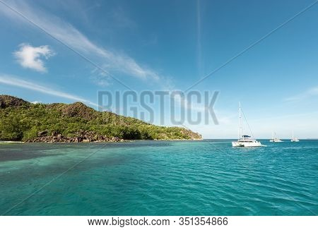 Catamarans In A Bay Near Curieuse Island In The Seychelles To The North Coast Of The Island Of Prasl