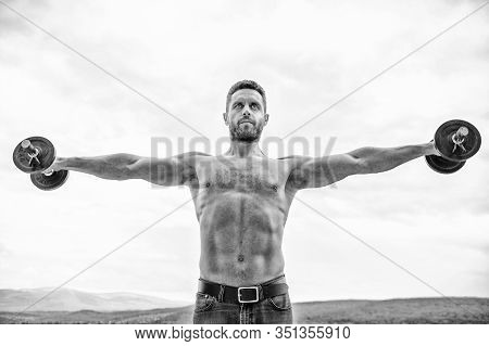 Hustle To Gain More Muscle. Healthy Mind In Healthy Body. Muscular Man Exercising With Dumbbell. Dum