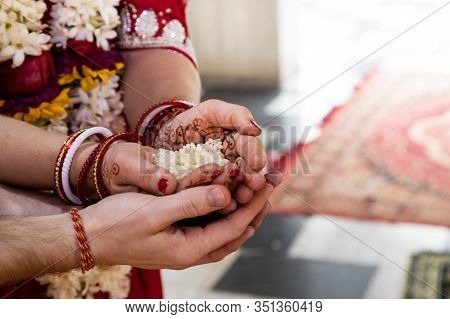 Indian Traditional Wedding. Authentic Vedic Wedding Ritual Called Vivaha Yajna. Red Sari, Women Hand