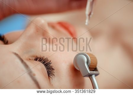 Beautiful Girl Woman In Spa Salon, Facial Rejuvenation Procedure.visit A Beautician.hyaluronic Acid