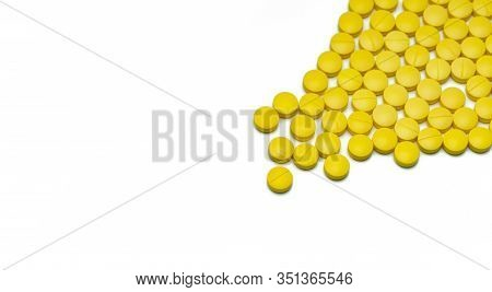 Yellow Small Round Tablets Pills On White Background. Healthcare Concept. Painkillers Medicine. Nons