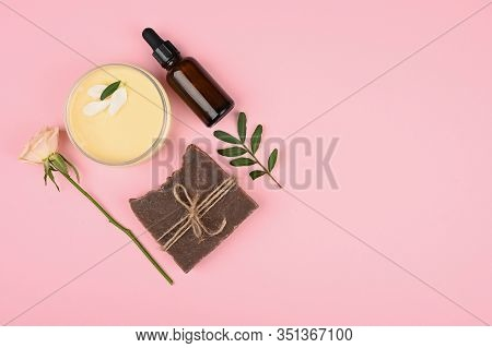 Skin Care Cream On A Pink Background. Cream Care In A Jar With A Beautiful Rose. Anti-aging Cream. C