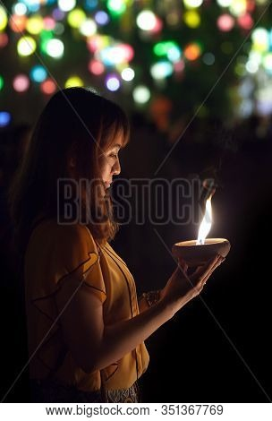 Chiang Mai, Thailand - November 9, 2019: Young Asian Girl Light The Candle To Pray In Loi Krathong F