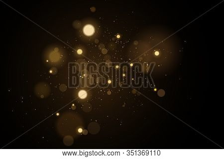 Abstract Golden Lights Bokeh On A Black Background. Glares With Flying Glowing Particles. Ligh Gold