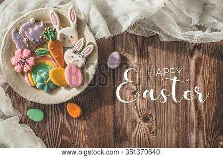 Happy Easter. Multi-colored Pastel Easter Cookies On A Wooden Background. Easter Concept