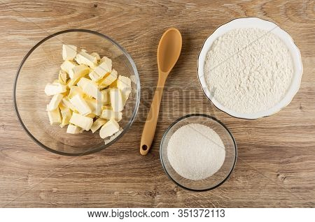 Ingredients (margarine, Wheat Flour, Sugar) In Bowls For Cooking Shortbread Cookie, Plastic Spoon On