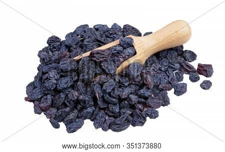 Black Raisins In A Scoop Isolated On White. Heap Of Black Raisins Close Up.