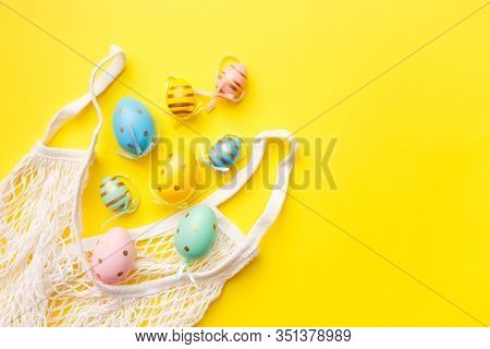 Easter Colored Eggs In A Bag On A Yellow Background. Happy Easter Greeting Card Concept. Top View, F