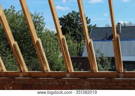 Roof Trusses Not Covered With Ceramic Tile On A Detached House Construction, Visible Roof Elements,