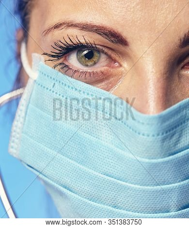 Doctors Face Close-up In A Surgical Cap And Armband.