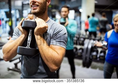 Group Of Fit People In Gym Training. Multiracial Group Of Friends Working Out Together