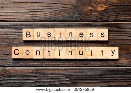 Business Continuity Word Written On Wood Block. Business Continuity Text On Wooden Table For Your De