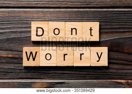 Dont Worry Word Written On Wood Block. Dont Worry Text On Wooden Table For Your Desing, Top View Con