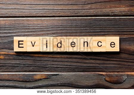 Evidence Word Written On Wood Block. Evidence Text On Table, Concept