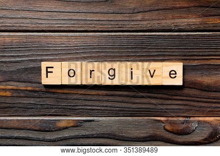 Forgive Word Written On Wood Block. Forgive Text On Wooden Table For Your Desing, Top View Concept
