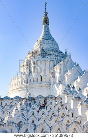 Tourist Poses At Sunset In Front Of Myatheindan Pagoda White Temple Near Irrawaddy River