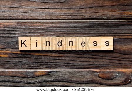 Kindness Word Written On Wood Block. Kindness Text On Table, Concept