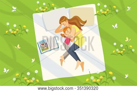 Mother And Daughter In Nature. Happy Family Spending Time On The Lawn Reading Books And Relaxing. Co