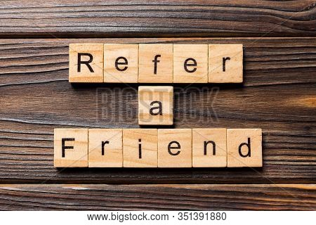 Refer A Friend Word Written On Wood Block. Refer A Friend Text On Table, Concept