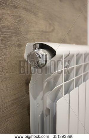 White Heating Radiator Heat The Room. Heating Radiator, White Radiator In An Apartment.