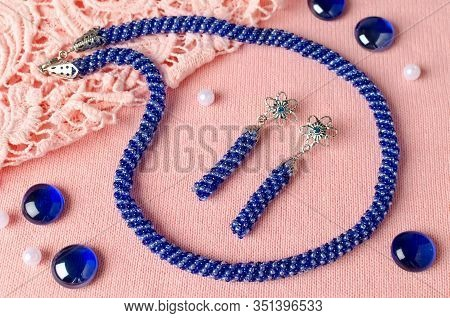 Necklace Made Of Small Beads Set With Handmade Earrings. Blue Bead Decoration