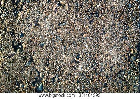 Texture Of Concrete Floor Background With Small Stones. Granular Texture Of Concrete With Gravel Par