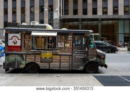 New York City, Usa - June 6, 2019: A Traditional Food Truck Parked On The Side Of The Street In Manh