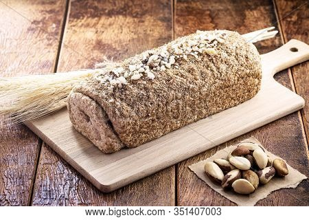 Vegan Product Made At Home, Totally Organic. Bread On Rustic Wooden Background, With Brazilian Produ