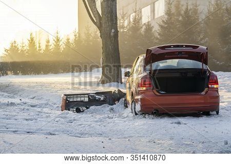 The Red Car Was Involved In An Accident On A Winter Highway And Flew Off The Road To The Side Of The