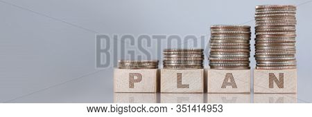 Column Of Silver Quarters Standing At Wooden Cubes As Exponential Rising Chart Of Planning Profits C