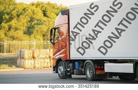 Huge Truck Move With Donation Supplies Inside, Help To The Poor Coutries On The Earth
