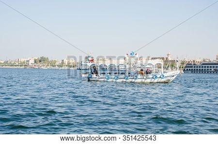 Luxor, Egypt - January 16, 2020 : Nile River Near Luxor, Egypt. Motor Boat On The Nile River In Egyp