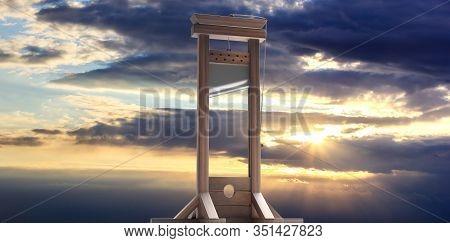 Guillotine Against Sunrise Sky Background. 3D Illustration
