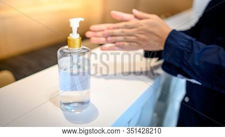 Washing Hands By Alcohol Sanitizers Or Alcohol Gel From Pump Bottle In Public Area. Wuhan Coronaviru