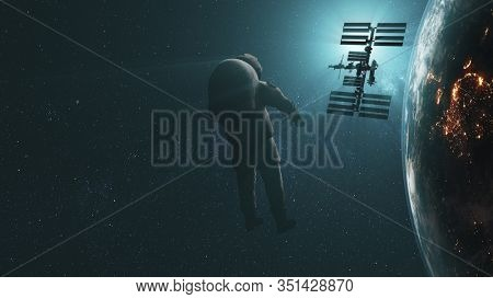Realistic spaceman fly to revolving ISS Sun flare. Planet Earth night day transition. International Space Station orbiting. 3d animation. Distant world discovery. Elements of media furnished by NASA.