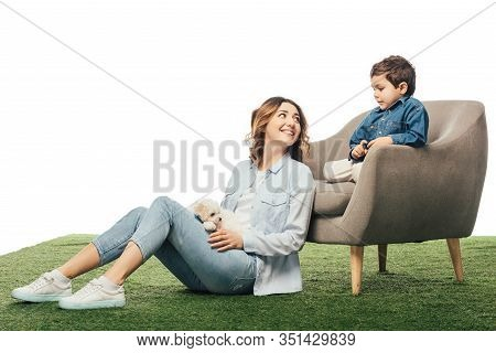 Smiling Mother With Havanese Puppy Looking At Son Isolated On White