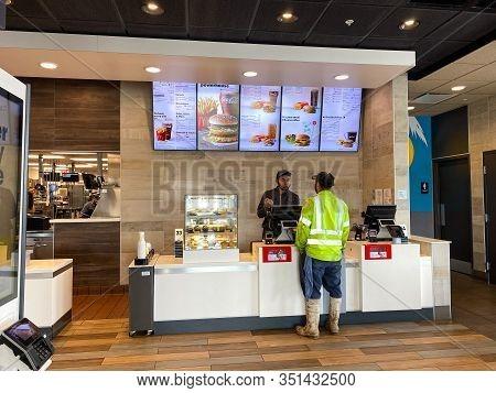 Orlando, Fl/usa-2/18/20: Mcdonalds Employee Taking A Customers Order.
