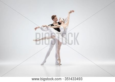 Love. Graceful Classic Ballet Dancers Dancing Isolated On White Studio Background. Couple In Tender