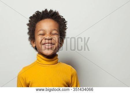 Cute Schoolboy Black Kid Boy Laughing On White Background