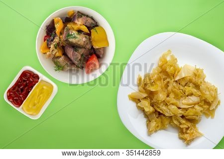Stewed Cabbage In A White Plate On A Lime Background. Stewed Cabbage Top View. Healthy Eating. Veget