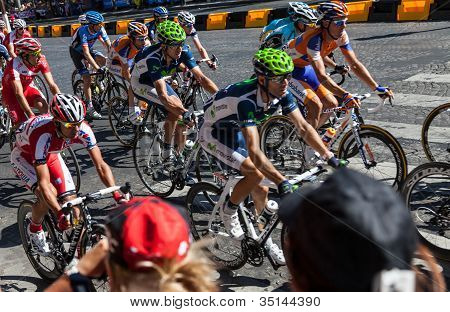Tourists Photographing The Tour Of France