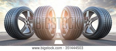 Four car wheel oln the highway with sky background.  Change a tires. 3d illustration